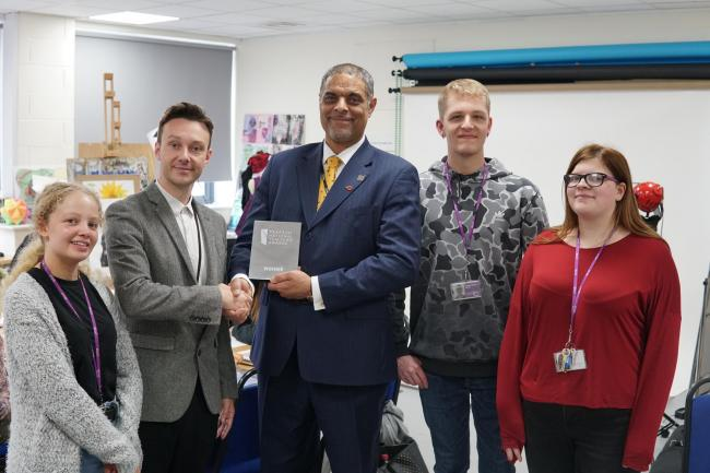 Scott Hayden, second left, receives the award from Anthony Bravo (centre)