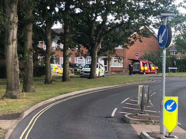 Three police cars and a fire investigations unit are dealing with an incident on Porter Road