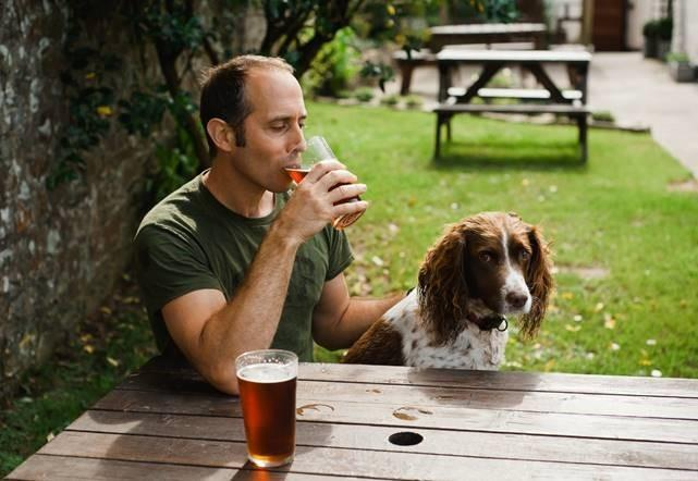 Man with a dog in a pub
