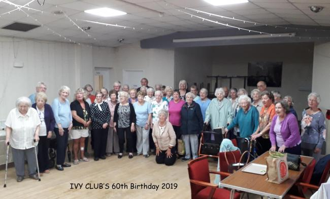 Members celebrate the Ivy Club's 60th birthday