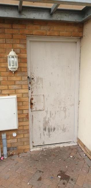 Basingstoke Gazette: The front door to the flat overtaken by squatters
