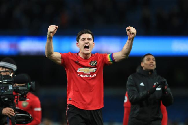 Manchester United's Harry Maguire celebrates victory over Manchester City