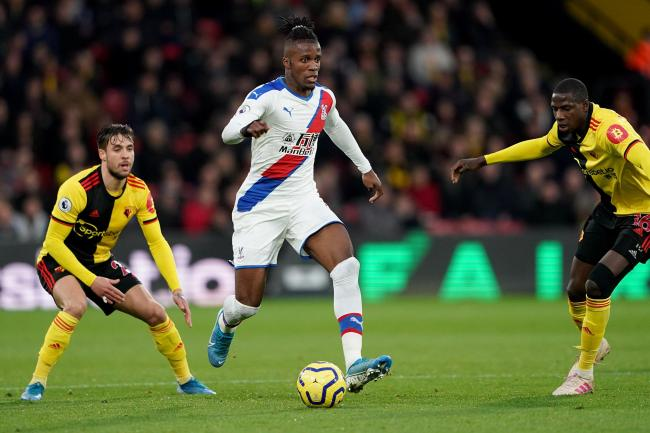 Crystal Palace's Wilfried Zaha (centre) was heavily linked with a move in the summer transfer window