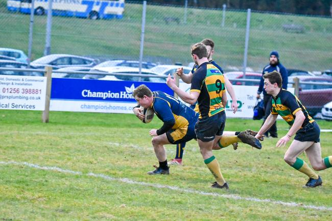Adam Clayson scores the opening try