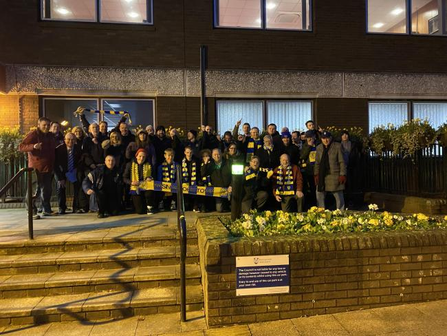 Fans gathered outside the council to show support for the loan to be approved by the council.