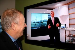 Cllr Keith Chapman chats with BT Retail regional manager Peter Cowen via a video link on super-fast broadband
