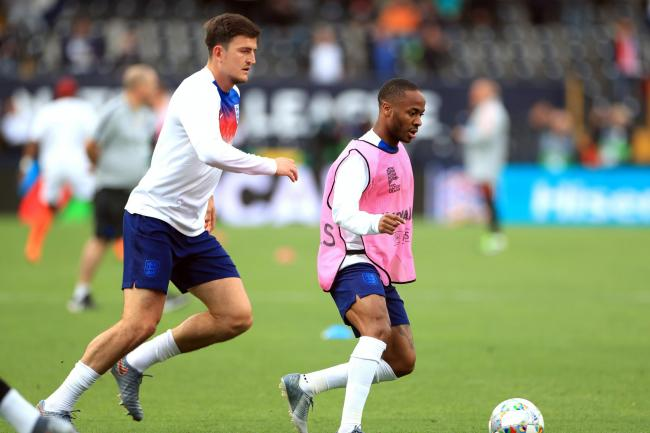 England team-mates Harry Maguire (left) and Raheem Sterling marked the anniversary of the Manchester bombing