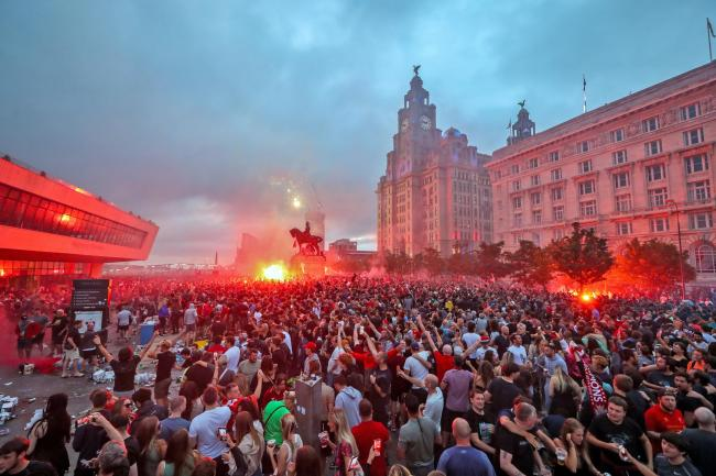 Supporters gather close to the Liver Building in Liverpool city centre on Friday night