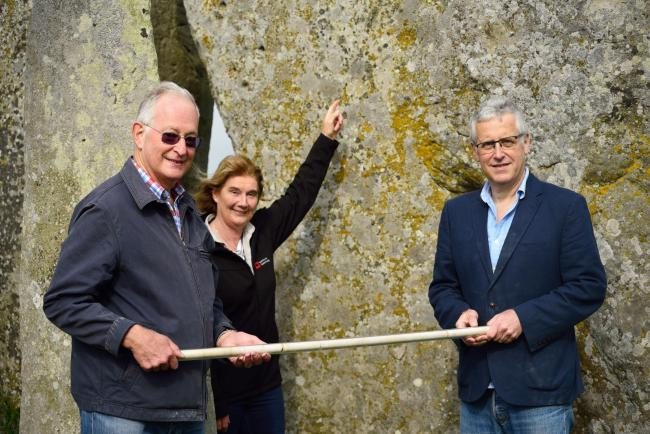 Return of the core from Stone 58 at Stonehenge to English Heritage in 2018. Pictured (left to right) Lewis Phillips, Heather Sebire (English Heritage) and RobinPhillips.Image credit Juliet Brain (English Heritage).
