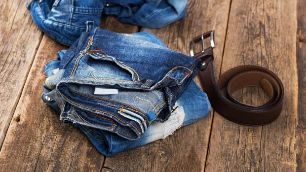 Basingstoke Gazette: A good pair of jeans doesn't need to be washed very often, but if they start to smell or feel loose and slouchy, it might be time to clean them. Credit: Getty Images / kozyrskyi