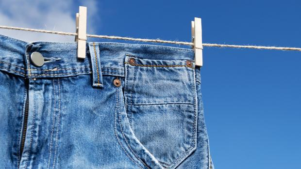 Basingstoke Gazette: Air drying your jeans is the best way to protect the material and fit of the jeans. Credit: Getty Images / Pavel1964