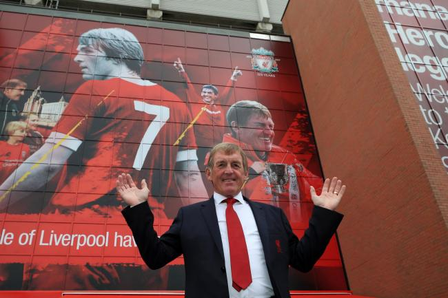 Kenny Dalglish stood in front of the stand which bears his name at Anfield