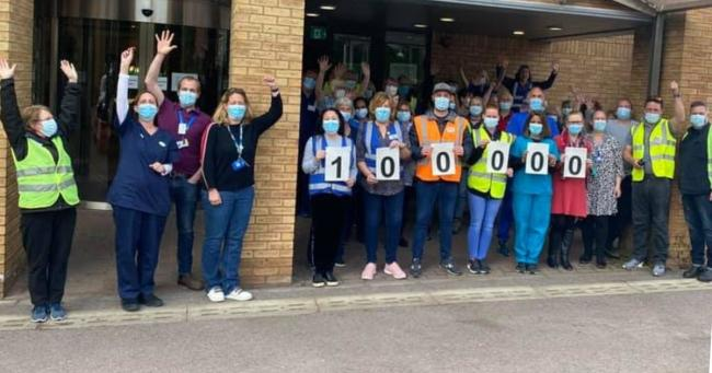 Medical staff and volunteers celebrate the milestone moment in front of Hampshire Court Hotel on Thursday