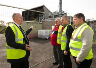 AWE chief executive Robin McGill (left) shows members of the AWE Local Liaison Committee around the site of the fire