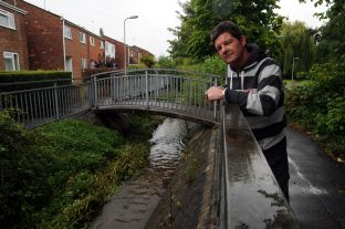 Peter Walker, looking at the Bishopswood Stream that flows past his Elmhurst home, in Tadley