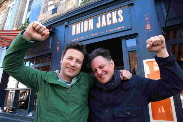 Jamie Oliver and partner Chris Bianco at the opening in May 2012
