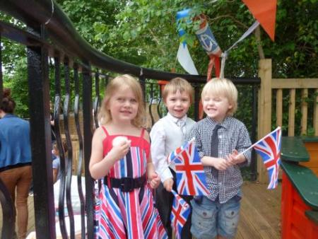 Children from JJ's Chatterbox Nursery enjoy a Jubilee garden party