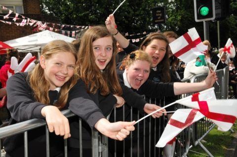 Schoolchildren watch historic torch relay