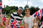 A family enjoy the Olympic Torch Relay