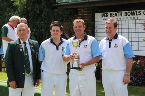 County President Steve Moore presents the triples trophy
