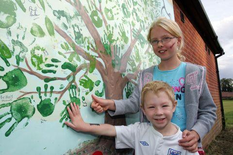 Oli Hart, four, and Becky Hart, eight, at the 'mood wall'