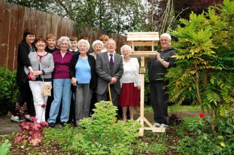 A bird table and commemorative plaque were presented to the residents