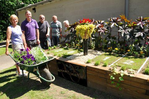 The Over 55's Club complete their Olympic flower bed.