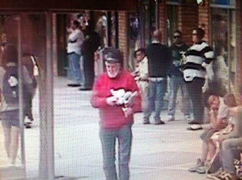 A CCTV image of the man police would like to speak to about the incident at Basingstoke bus station