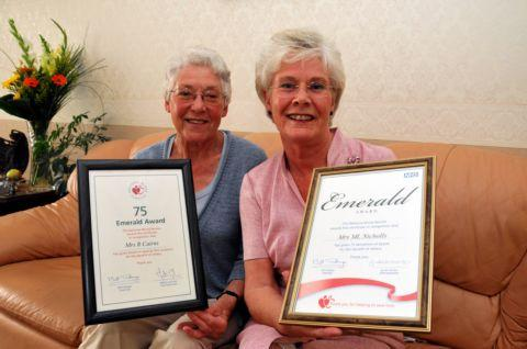 Ruth Cairns and Miriam Nicholls with their Emerald awards