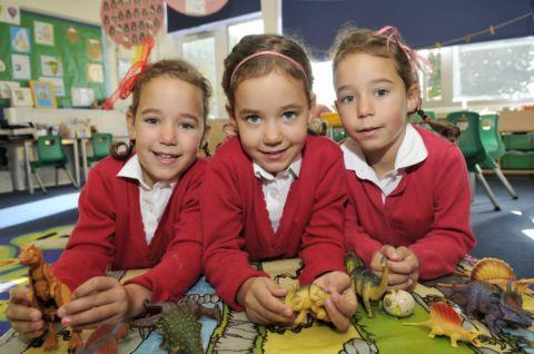 Four-year-old triplets Catherine, Mia, and Sophia Kesterton