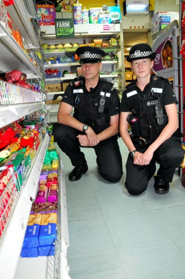 PC Bill Tweedie and PC Lucy Fawcett in the aisle where they discovered the pensioners stolen purse