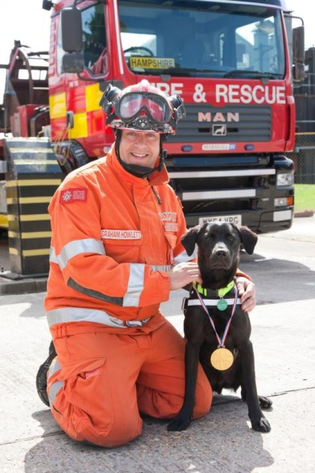 Harley the Labrador with his handler Graham Howlett