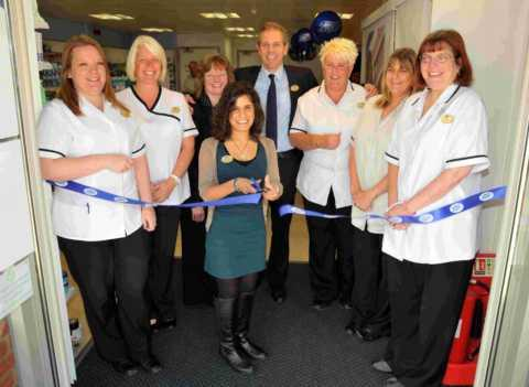 Pharmacist Poonum Patel with her team and area manager Andy Bell