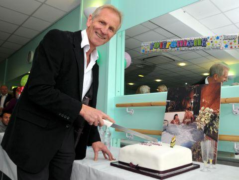 Steve Combes cuts his retirement cake