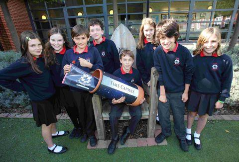 Children from St Bede with the time capsule. It will be sealed for 100 years.