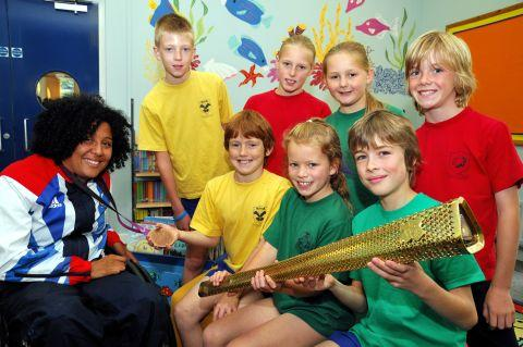 Alexandra Rickham with pupils Jack Sanford, 10, Lara Middleton, eight, Will McIntyre, 10, Oliver Barfield, 10, Luella Kent, 10, Katie Palmer, 10, and Calum Meechen, 10