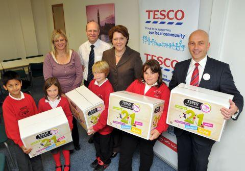 Basingstoke MP Maria Miller with pupils from Marnel Community Infant School and Marnel Junior School, Tesco store manager Paul Cavaliere, right, teaching assistant Dinah Shaw, from Marnel Infant School, and Paul Hopgood, a teacher at Marnel Junior School