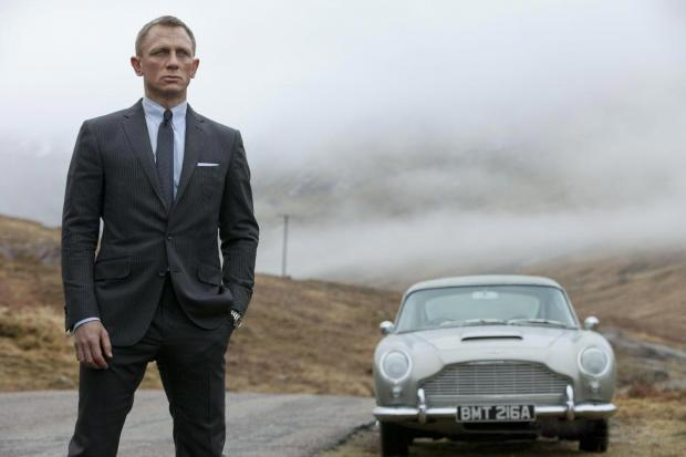 James Bond with the Aston Martin DB5 in Skyfall