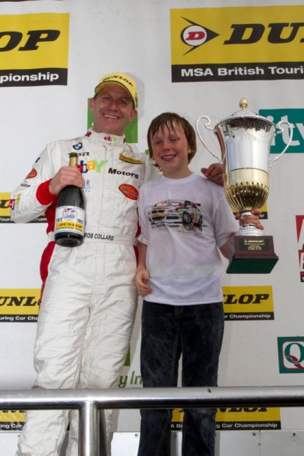 Rob Collard on the podium at Silverstone with his son Jordan.
