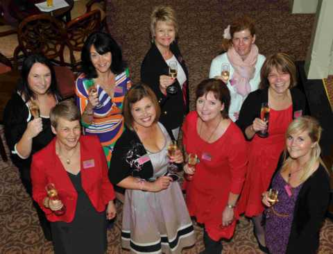 Women in BUsiness Group committee members celebrating the networing group's 20th a