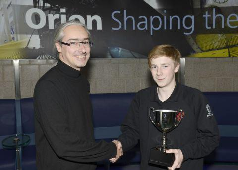Andrew Randewich presents Will Maidment with his trophy