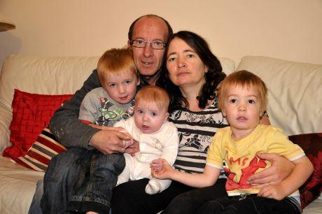 Kevin Smart and Rebecca Parker from Beckett Gardens, Bramley, with their children (from left), Joshua Smart, four, five month old son Union Jack Smart and Oscar Smart, three