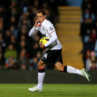 Manchester United's Javier Hernandez celebrates scoring his first goal at Villa Park