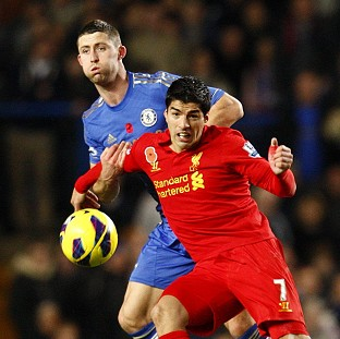 Luis Suarez, right, scored the equaliser for Liverpool deep in the second half