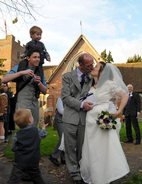 Becky Parker and Kevin Smart celebrate their wedding and the christening of their sons