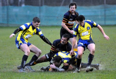 Basingstoke and Old Colfeians battle for the ball at a boggy Down Grange.
