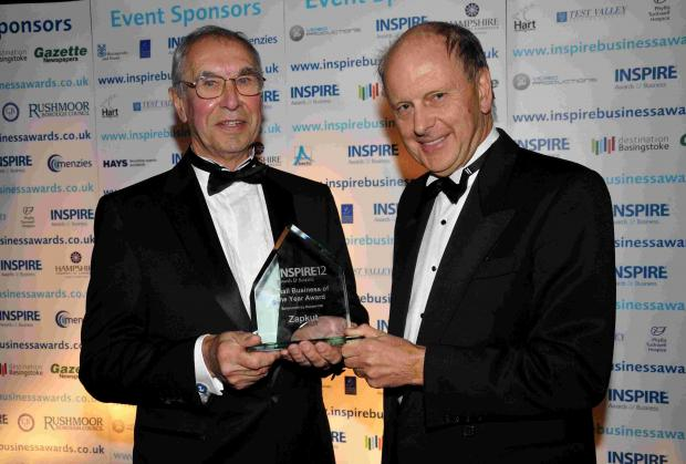 Basingstoke Gazette: Keith Bunker of Zapkut is presented with the Small Business of the Year Award from Paul Smith, chairman of Celador