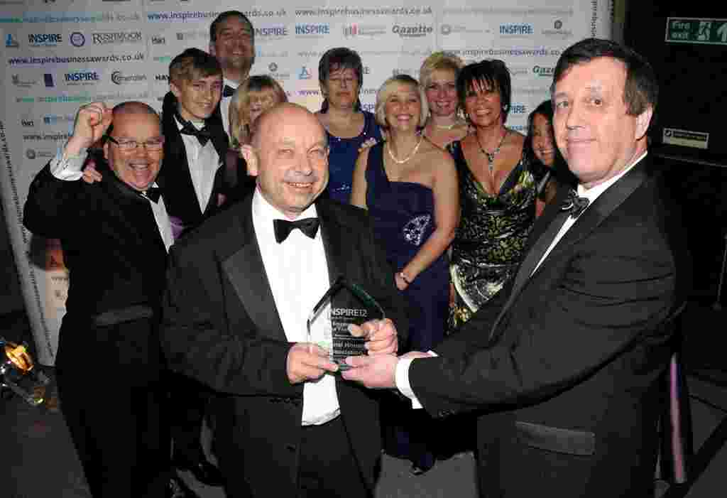 Sentinel's Martin Nurse receiving the Employer of the Year Award from David Smy of HW Chartered Accountants
