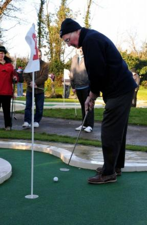 Basingstoke Minigolf Club's Charles Howard takes a putt.