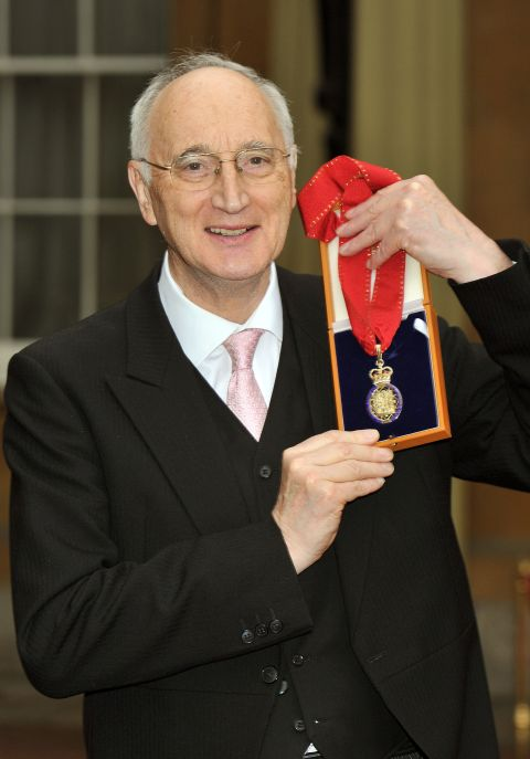 Sir George Young with his Companion of Honour medal